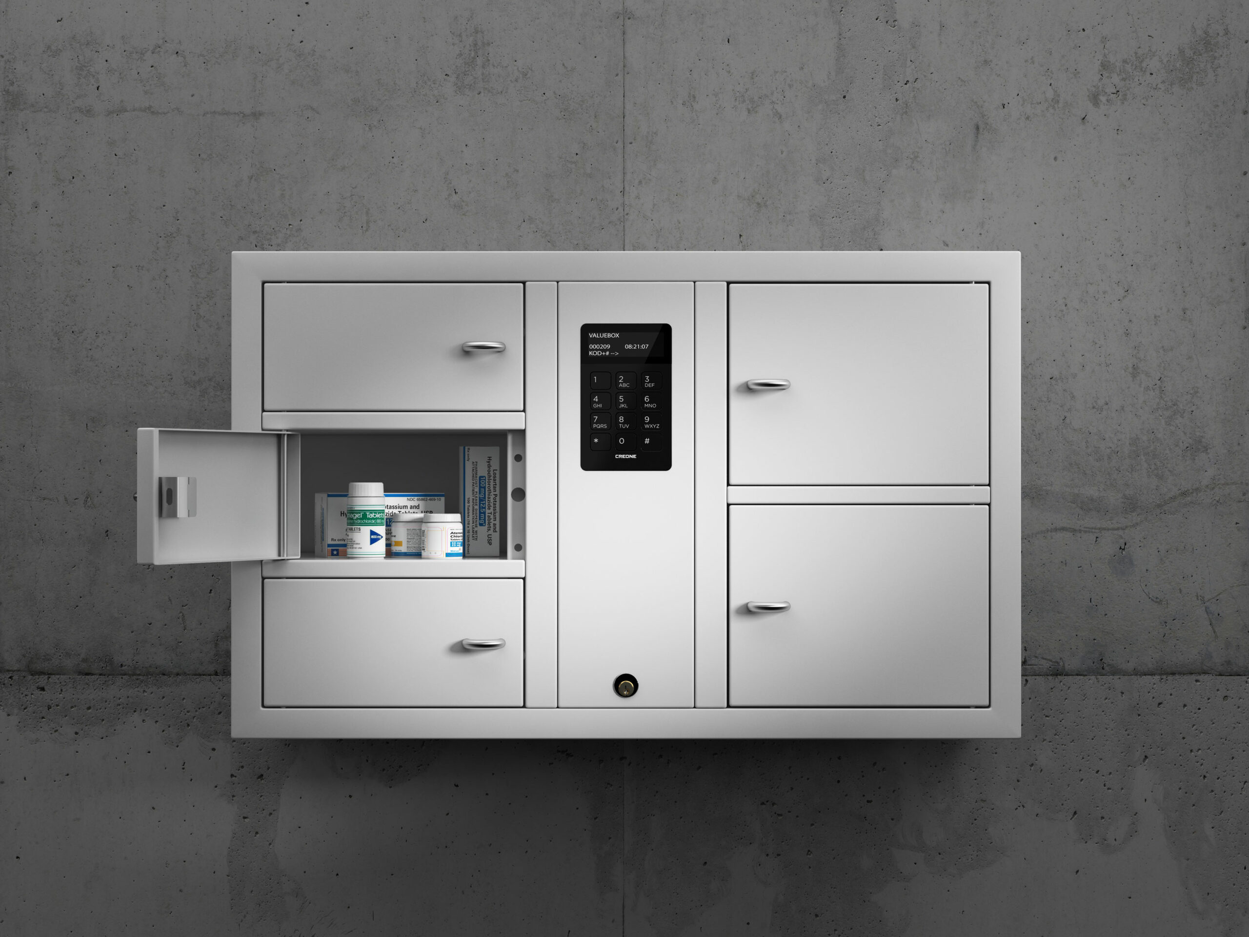 Valuables cabinet 7005 S in the System series. Mounted on the wall with open compartments containing medicines for collection.