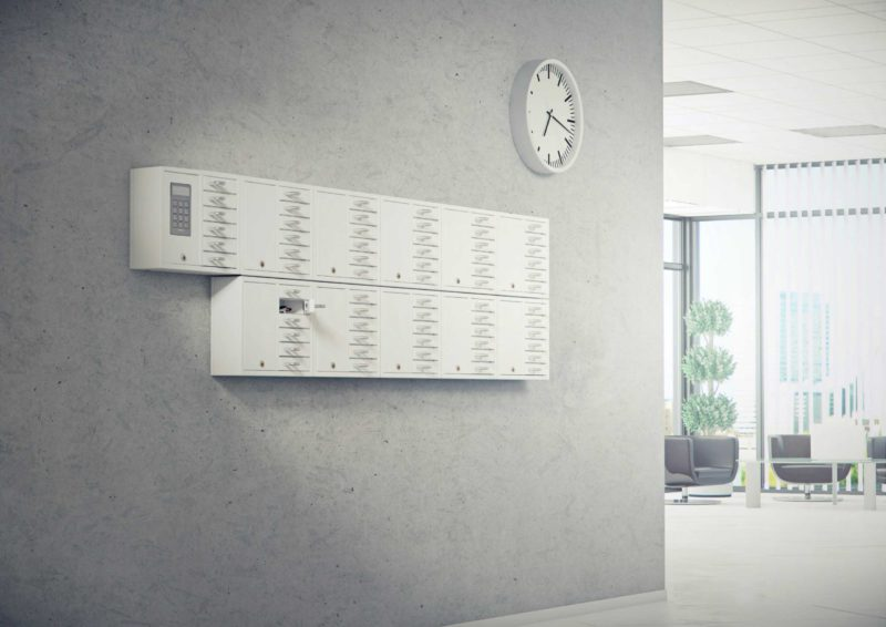 The 9006 S key cabinet from the System series plus ten of the 9006 E from the Expansion series is handling the company's key management. Mounted on the wall with open compartments containing bunches of keys.