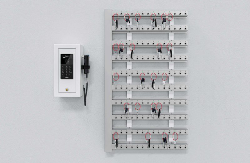Intelligent key strips with control box mounted on the wall for key management.