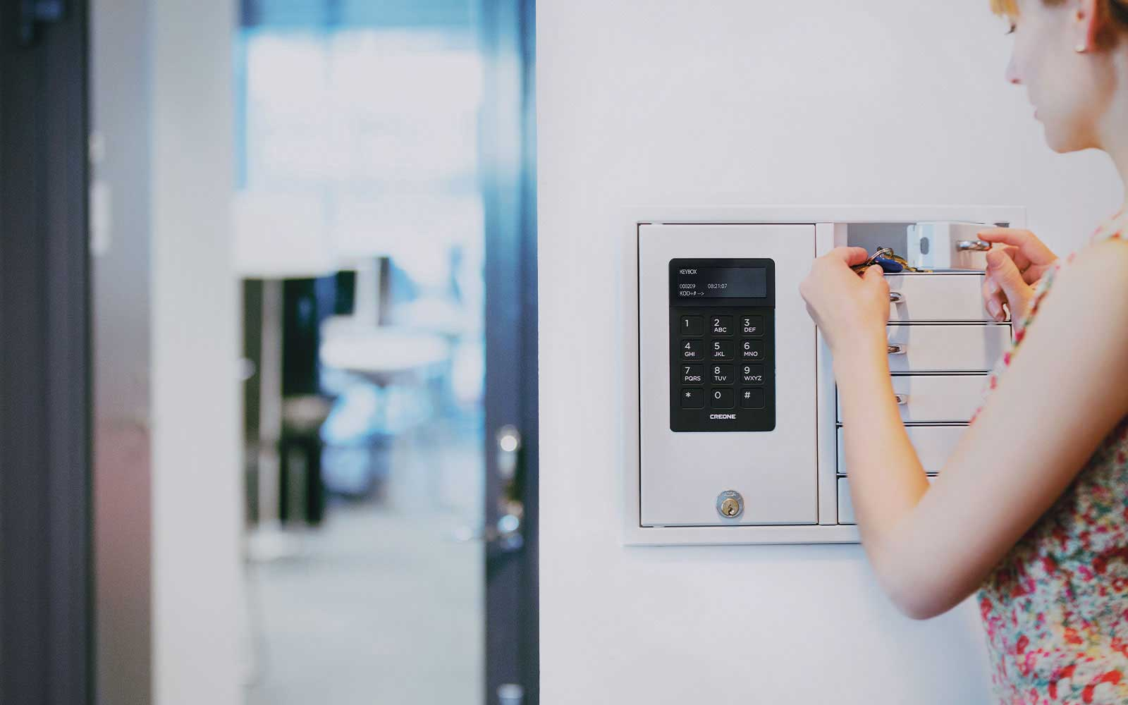 Key management with a key cabinet that has six compartments for key storage and key distribution